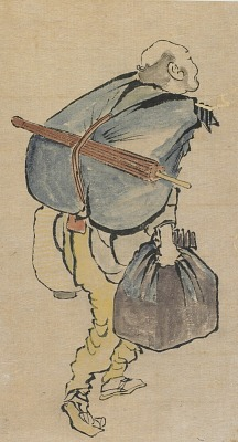 Man carrying back-pack and lantern