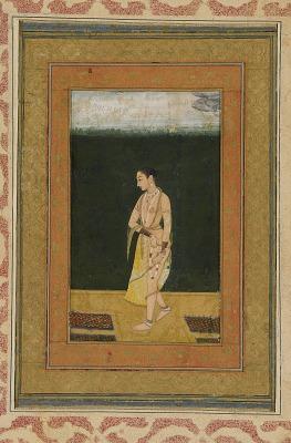 A Lady Walks in a Garden