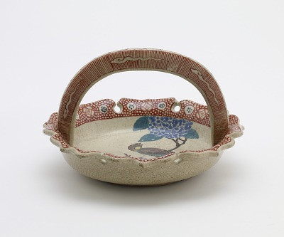 Banko ware serving dish with design of bird and hydrangea