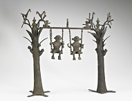 Two deities on a swing between toddy trees