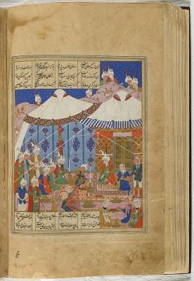 Folio from a <em>Khamsa</em> (Quintet) by Nizami (d.1209); verso: illustration: Khusraw and Shirin are feasting at night in a desert encampment; recto: text