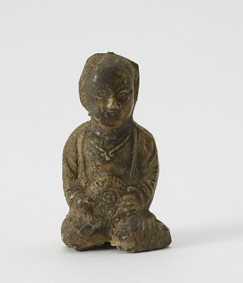 Figure of seated child