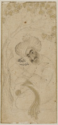 Seated man holding a book