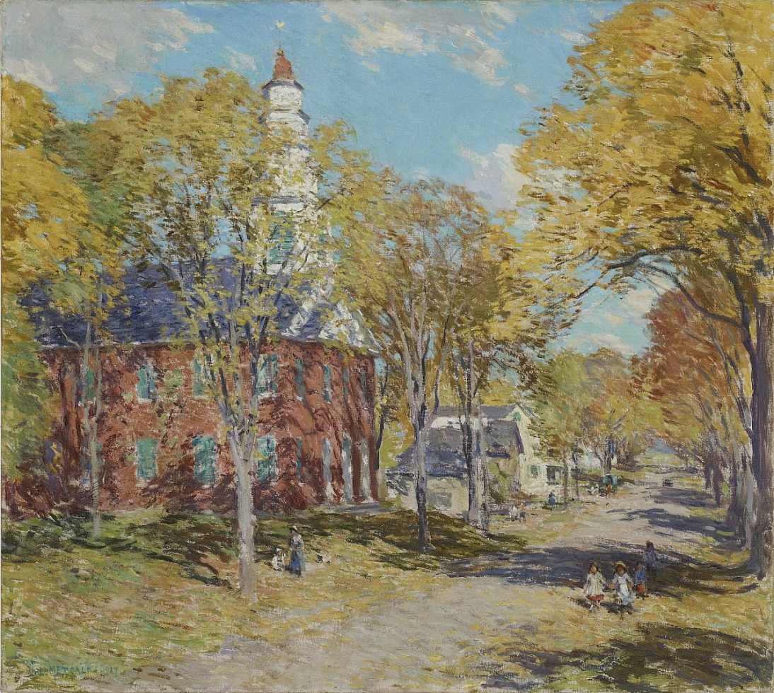 Square landscape of a New England church along a tree lined road in Deerfield, Mass. on an October morning, the leaves on the trees and falling on the ground have begun turning yellow