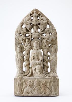 Buddhist stele of a seated bodhisattva (Maitreya) flanked by standing bodhisattvas