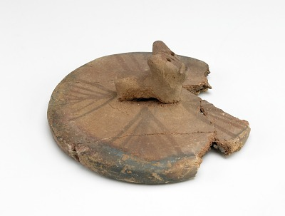 Cover (fragmentary) with applied handle of recumbent bull