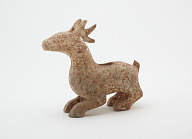 Figure of a crouching stag with horns (forgery)