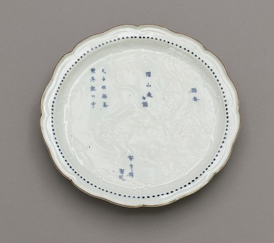 Dish with molded design of parable of filial piety and inscribed poem