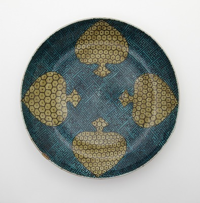 Dish with design of four spades
