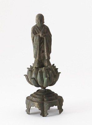 Figure of a Buddhist monk standing on a lotus