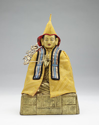 Figure of a lama, with silk hooded robe