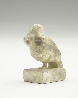 Figure of a bird on a plinth