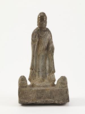 Standing Buddha (<em>Shakyamuni</em>) with lions