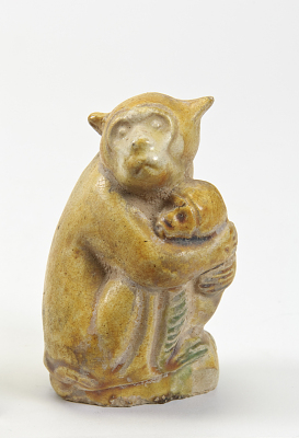 Monkey holding baby monkey