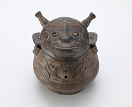 Vessel with lid in form of human face, type <em>huo</em>