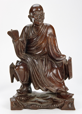 Figure of a scholar with a book
