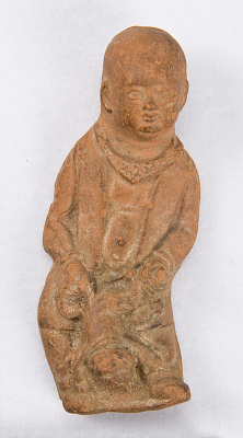 Figure of a boy with a dog