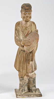 Figure of standing male attendant holding pillow