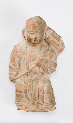 Figure of a boy holding a lotus leaf (fragment)