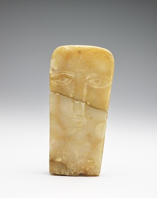 Face stela, in two pieces, now joined
