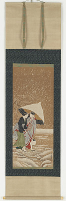 Two girls under umbrella in snowstorm