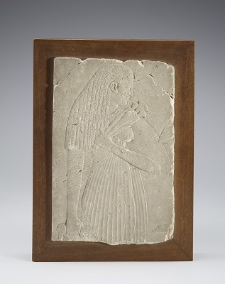 Relief fragment with a female figure