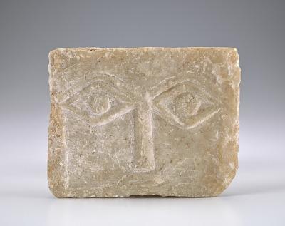 Face stela