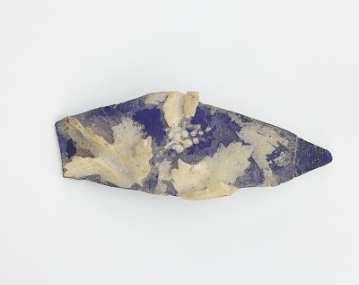 Carved glass fragment