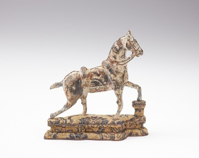 Figure of a saddled horse