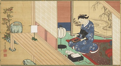 Girl sitting on her bed near an outer doorway and grinding ink