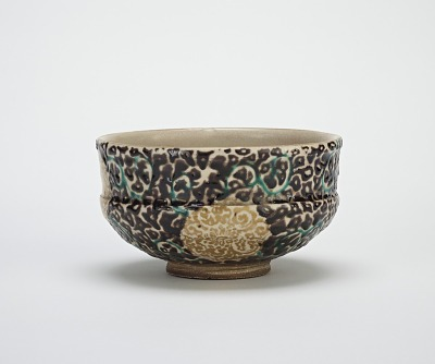 Tea bowl with silk brocade design