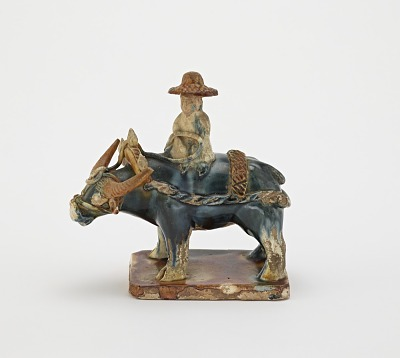 Tomb figure of water buffalo and rider