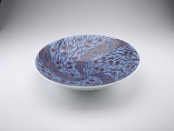 Bowl with design of flowers and grasses