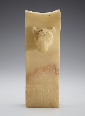 Stela with bull's head, inscribed below