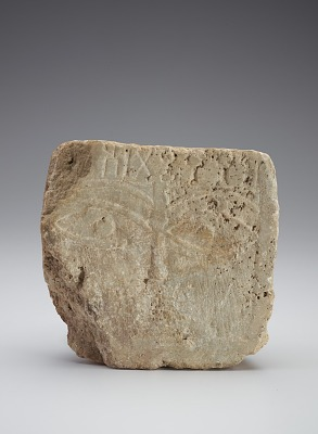 Face stela with patial inscription