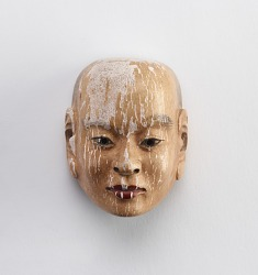 Twenty miniature masks