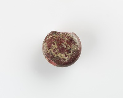 A Round marker for games. Chipped