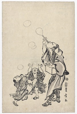 Man blowing bubbles for children