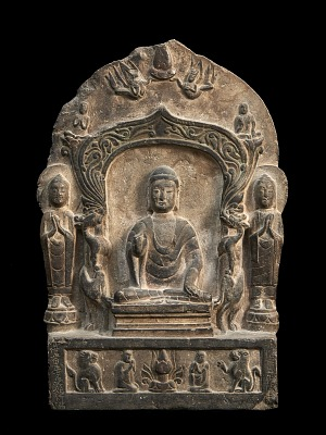 Buddhist memorial stele, decorated on the front with a flat niche in which the Sakyamuni Buddha is seated on a low pedestal