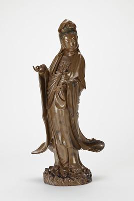 Bodhisattva Avalokiteshvara (Guanyin) standing on waves and lotus