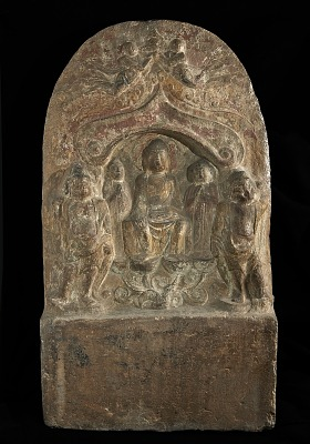 Buddhist tablet: rectangular base and rounded top; on obverse, figures in high relief, including central seated figure with two supporters on either hand, and two angels above; inscriptions