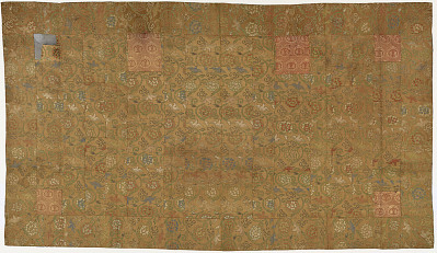 Brocade, silk. A Buddhist monk's robe, patched; kesa 袈裟. One patch partly cut away