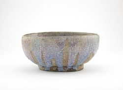 Oval serving bowl in shape of rice bale