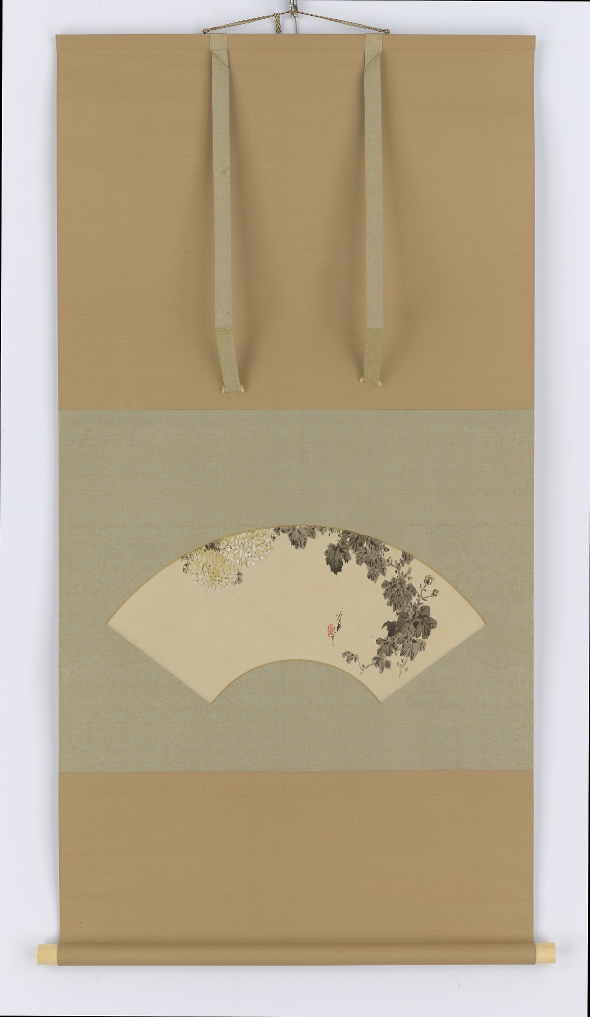 Painted fan with design of chrysanthemum flowers mounted on a hanging scroll.