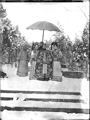 The Empress Dowager Cixi in snow accompanied by attendants 1903-1905