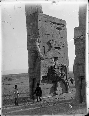 Persepolis (Iran): Gate of All Lands, Colossal Sculptures Depicting Man-Bull (Sevruguin in White Coat) [graphic]