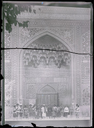 Isfahan (Iran): Madrasa-i Madar-i Shah: View of Cossack Officers Standing in front of Entrance Iwan [graphic]
