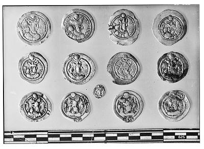 Obverse of Thirteen Sasanian Coins, Including Several of King Yazdagird II, King Peroz, and King Bahram V [graphic]