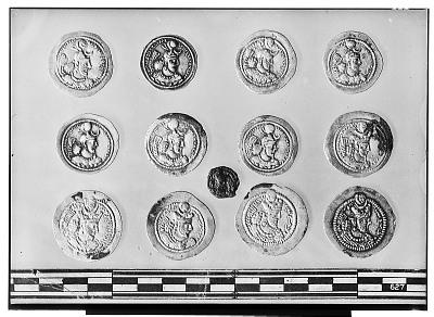 Obverse of Thirteen Sasanian Coins, Including Several of King Yazdagird II and King Bahram V [graphic]