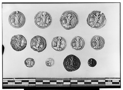 Obverse of Thirteen Sasanian Coins, Including Several of King Shapur II [graphic]